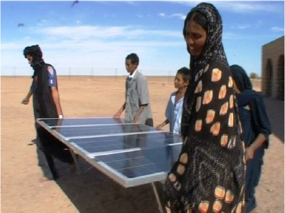 Default_family_carrying_big_solar_panel_in_desert_area