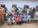 Thumb_bunker_roy_with_group_of_women_solar_engineers_seating