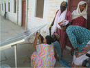 Thumb_woman_solar_engineers_installing_solar_panel