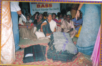 Big_distribution_of_blankets__rice__sarees__shirts__vessels_to_t