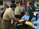 Thumb_i%20m%20%20giving%20%20%20stationeries%20%20for%20poor%20students.4jpg